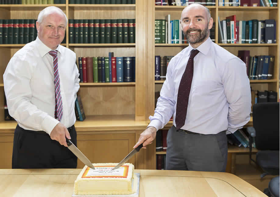 John Duggan & John Kelly cutting Callan Tansey cake