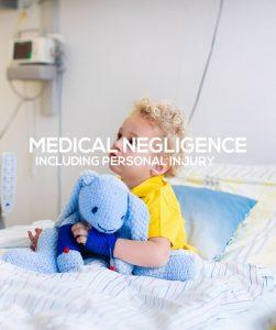 Little boy on hospital bed holding blue toy elephant