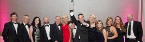 Callan Tansey team winner of Irish Law Awards & Roger Murray holding up medal