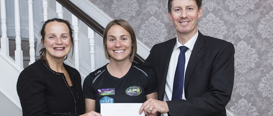 Niamh Ni Mhurchu and Brian Gill Partners presenting Laura Tighe with sponsorship cheque.