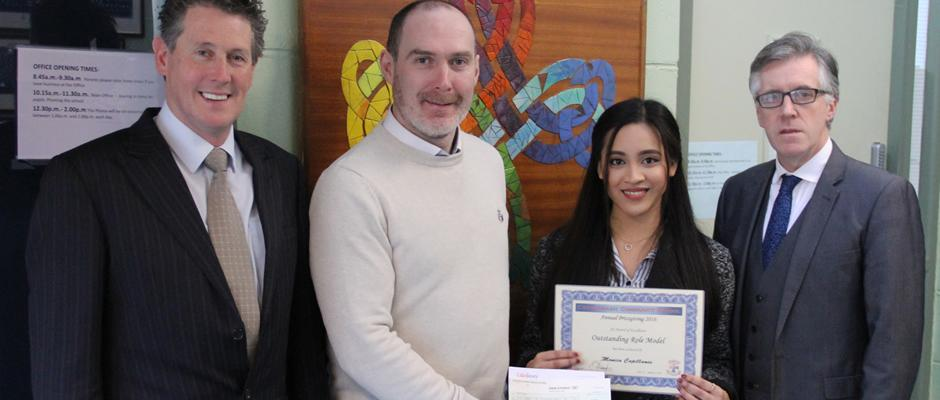 John McGuinness (VP), Brian McNally and Paul Fiorentini (Principal) presenting Carndonagh Community School winner of The Callan Tansey Dilseacht Award 2016 to Monica Capillanes.