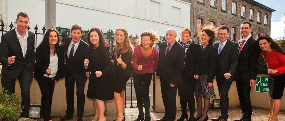 Sonia O Sullivan, David Matthews and Callan Tansey staff pretending to run whilst stationary outside Callan Tansey offices