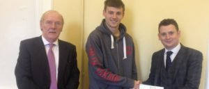 Our David O'Malley presenting the Dilseacht award to Jack Irwin for his hard work at St Muredachs
