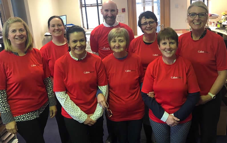 Callan Tansey staff in red t.shirts after raising funds for Temple St hospital