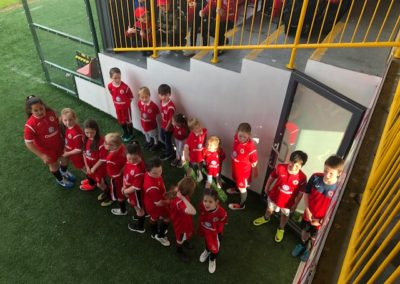Children in Sligo Rovers kit about to walk on pitch