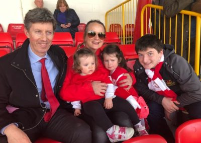 Callan Tansey staff members with children at Sligo Rovers game