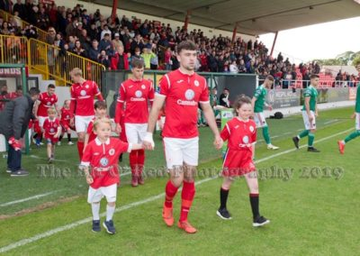Sligo Rovers team members coming out on pitch with mascots