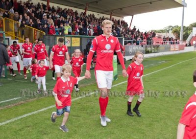 Sligo Rovers Team coming on pitch with children mascots