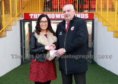 Caroliine McLaughlin giving cheque to Sligo Rovers staff