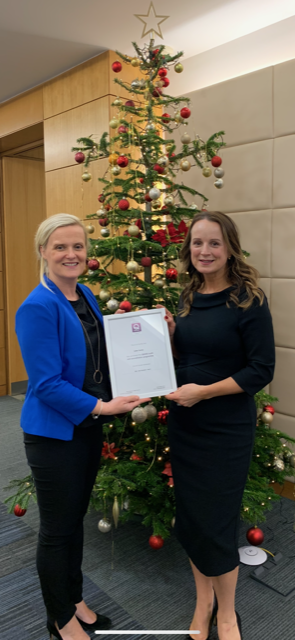 Niamh Receiving Q6000 Accreditation from Julie Brennan, Institute of Research and Legal Standards